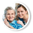 caregiver and smiling old woman